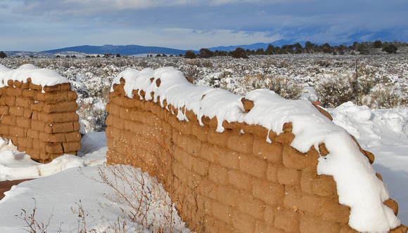 adobe wall and snow